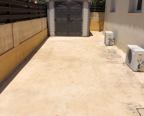 Driveway with storage unit